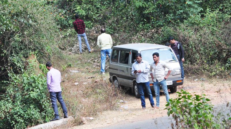 Tourists relieve themselves on the ghat road to Araku on Monday.  (P. Narasimha Murthy)