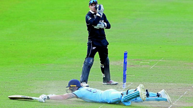 England's Ben Stokes dives in to make his ground and get a 6 from overthrows during the final on Sunday. (AP)