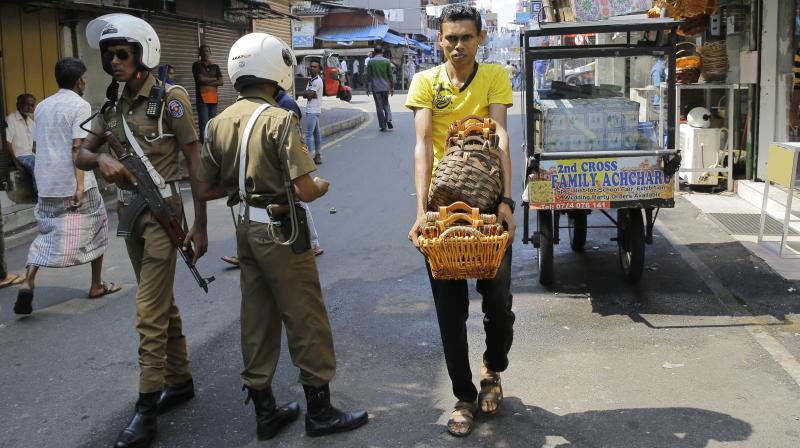 Local police officers have detonated the bomb and removed the motorbike. (Photo:AP)