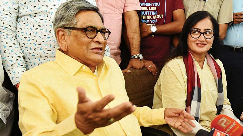 Sumalatha Ambareesh with BJP leader S.M. Krishna in Bengaluru on Friday. (Photo: DC)