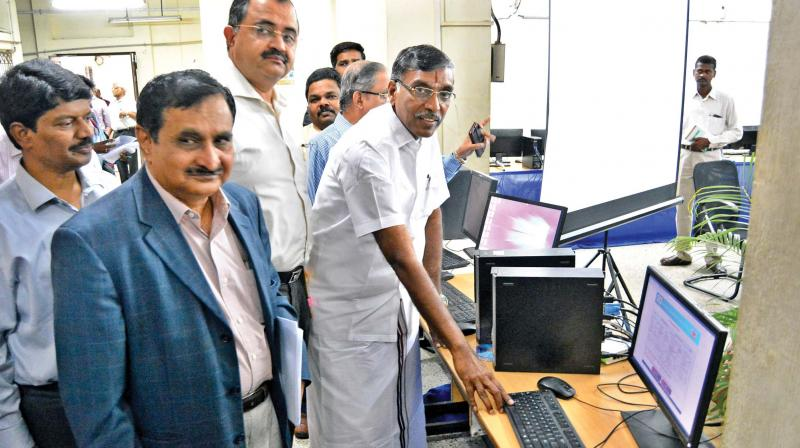 Higher education minister K.P. Anbalagan inaugurating the process to allocate random numbers to engineering applicants on Tuesday here. Higher education secretary Sunil Paliwal and Anna University Vice-Chancellor  M.K. Surappa also seen (Photo: DC)