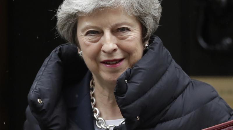 May, who secured the leadership in the chaos that followed Britain's 2016 vote to leave the European Union, has promised to step down if lawmakers back the deal. (Photo:AP)