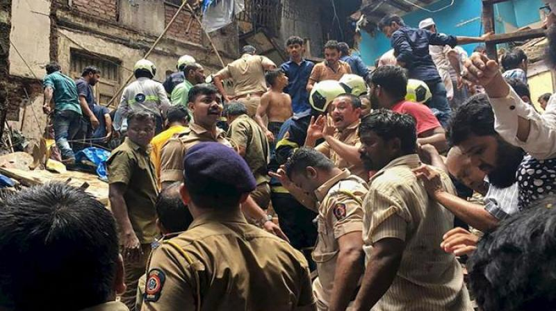 Mumbai's congested Dongri area has gone up to 13 — five men, three women, four minor boys and a minor girl — while 10 people in total were injured. (Photo: AP)