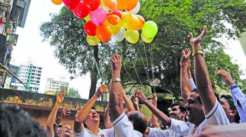 Indian friends of Kulbhushan Jadhav, celebrate verdict of International Court of Justice in Mumbai on  Wednesday. (Photo: AP)