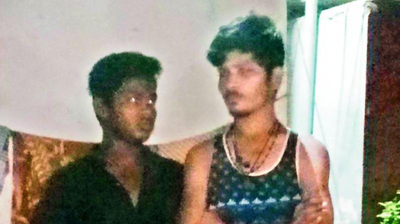 The two men who were caught by the locals and handed over to the police for capturing cats.