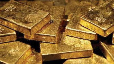 Globally, spot gold was trading almost flat at USD 1,415.80 an ounce, while silver was up at USD 15.50 an ounce in New York.