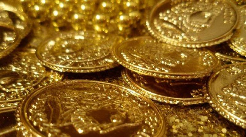 Globally, gold rose 0.39 per cent to USD 1,290.80 an ounce. (Photo: PTI)