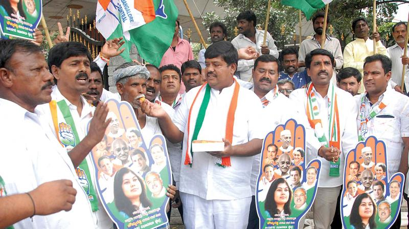 Congress workers  celebrate the victory of Congress candidate Sowmya Reddy in Jayanagar assembly constituency on Wednesday. (Photo:KPN)