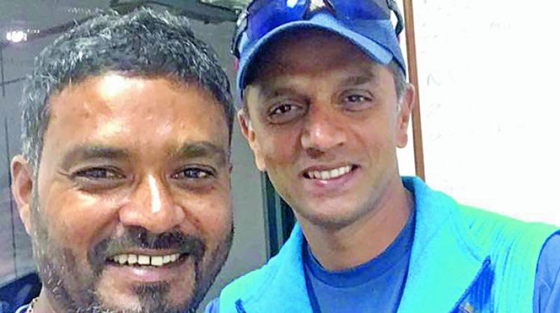 Noel David shares a light moment with NCA head Rahul Dravid in this file photo.