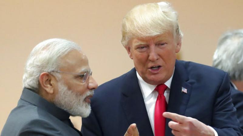 India's Prime Minister Narendra Modi, in conversation with US President Donald Trump during a working session of the G20 summit in Hamburg, Germany, Saturday, July 8, 2017. (Photo: AP)