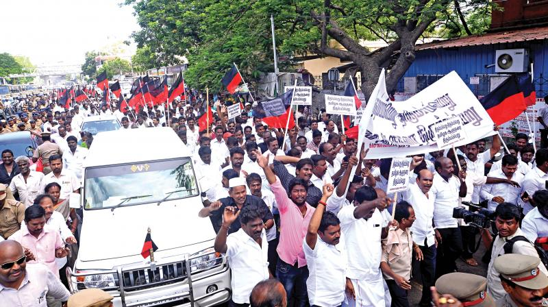 Opposition DMK members march towards Raj Bhavan raising slogans demanding recall of Governor Banwarilal Purohit. Former Mayor Ma.Subramanian led the march. (Photo:DC)