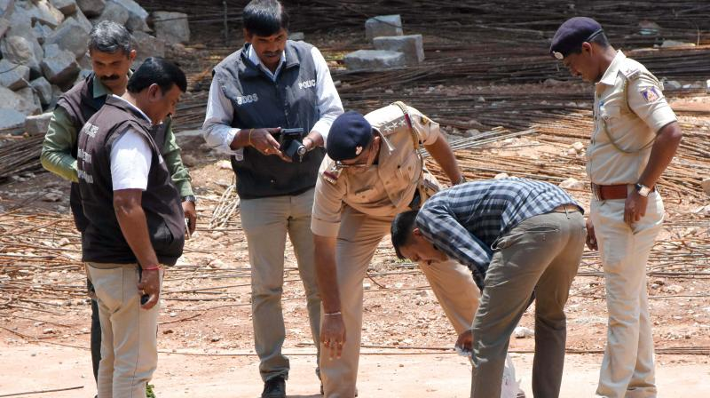 The bomb squad at the spot where the blast took place in Vyalikaval in Bengaluru on Sunday (Photo: DC)
