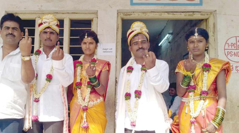 Newly married couples after voting in the Chincholi Assembly bypoll on Sunday.