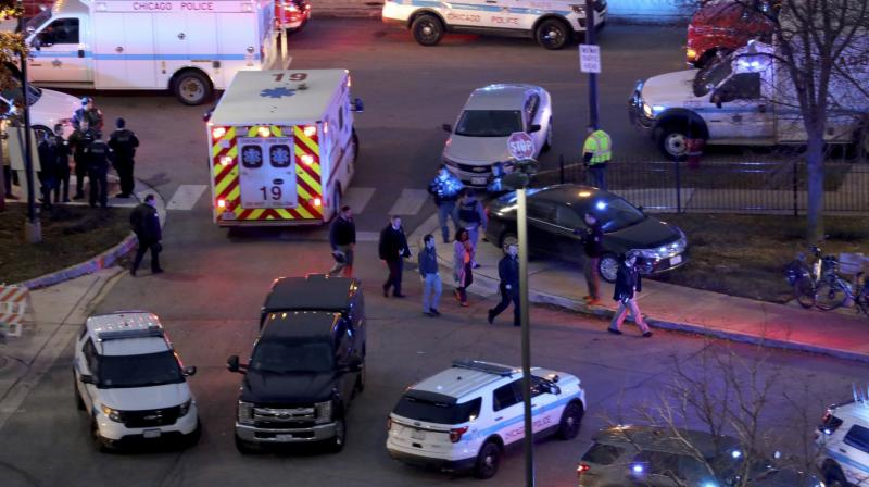 The identities of the other victims, and the gunman, were not immediately released. (Photo: AP)