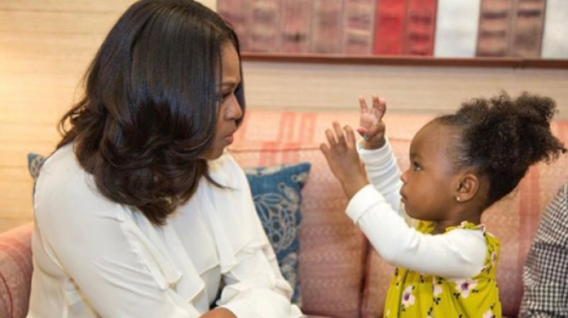 Little girl seen admiring Michelle Obama portrait meets former first lady