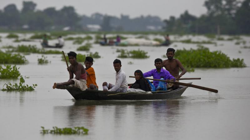 Indian flood affected villagers travel on boats in Burha Burhi village, east of Gauhati, Assam, India, Monday, July 15, 2019. (Photo: AP) (Photo: AP)