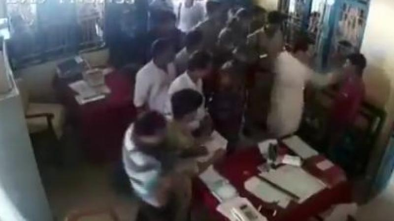 A video showing Debburman assaulting Mintu Debbarma inside a police station in Khowai district, around 50km from here, has gone viral on social media.  (Image: ANI twitter)