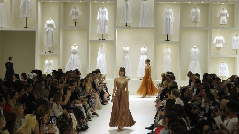 Models wears creations for Dior Haute Couture Fall-Winter 2018/2019 fashion collection presented Monday, July 2, 2018 in Paris.(Photo: AP)