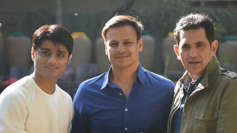 PM Narendra Modi producer Sandip Ssingh, Vivek Oberoi and Omung Kumar. (Photo: Twitter)