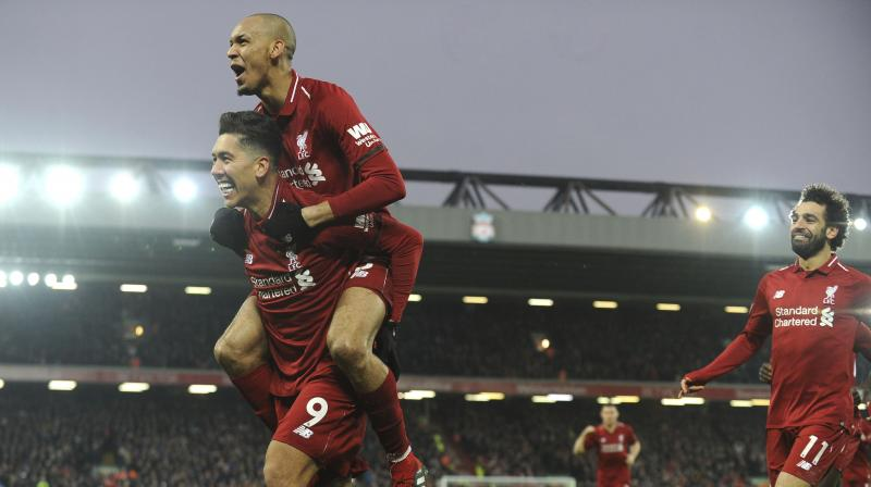 Firmino celebrates with his teammate Fabinho and Salah after scoring his side's second goal during the match between Liverpool and Crystal Palace. (Photo: AP)