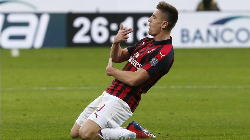 AC Milan's Krzysztof Piatek celebrates after scoring his side's second goal during an Italian Cup quarter-final soccer match between AC Milan and Napoli. (Photo: AP)