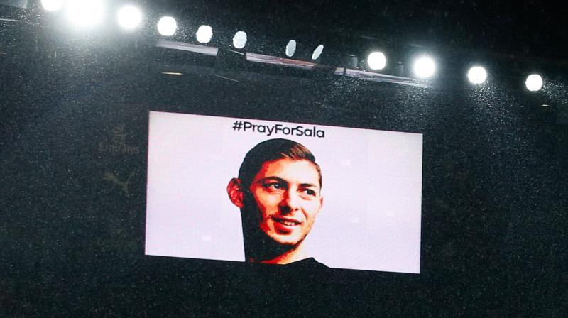 The big screen shows the face of Emiliano Sala during a moments silence in his honour ahead of the match between Arsenal and Cardiff City. (Photo: AFP)