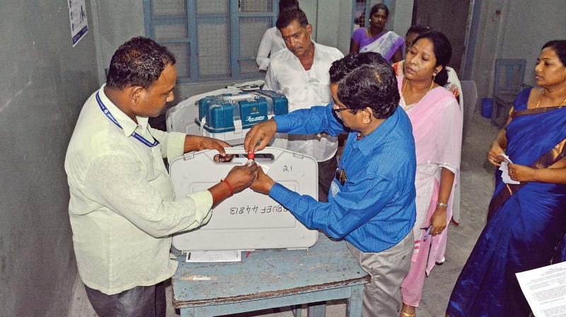 EC officials sealing the EVMs after the completion of  voting at Valliammal School in Anna Nagar late Thursday evening. The EVMs were later transferred with heavy police escort to Anna University for counting of votes next month. (Photo: DC)