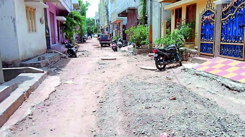 The road work left unfinished at Renuka Colony.