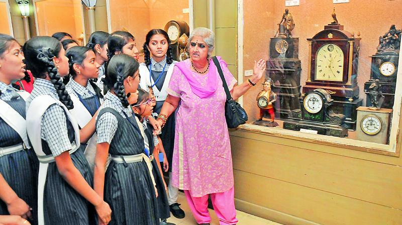 Intach, Hyderabad Chapter, convenor P. Anuradha explains to visitors the antique clocks at the Special Historic Clock Collection housed in the Salar Jung Museum, Hyderabad, on Saturday. (Photo: DC)
