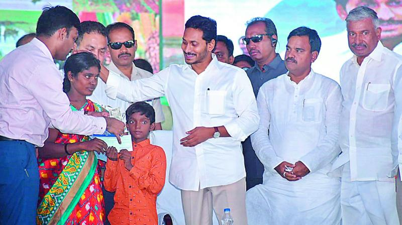AP Chief Minister Y.S. Jagan Mohan Reddy after presenting `7 lakh cheque to a widow Ramasubbamma in Kadapa on Monday. (DC)