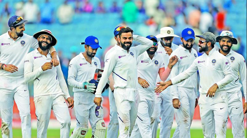 Team India celebrate after winning the second Test against South Africa in Pune.