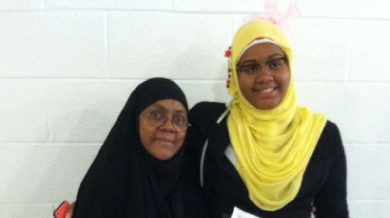 Je'Nan Hayes (right) of Watkins Mill High School in Gaithersburg, Maryland, was barred from playing a basketball game at her high school because of the headscarf she was wearing. (Photo: Facebook)
