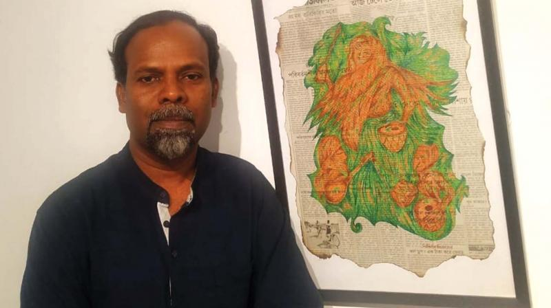 Artist Subhash Thodayam paints on newspapers collected from random areas