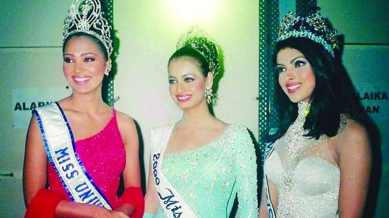 Lara, Dia and Priyanka pose after their pageant win in 2000.