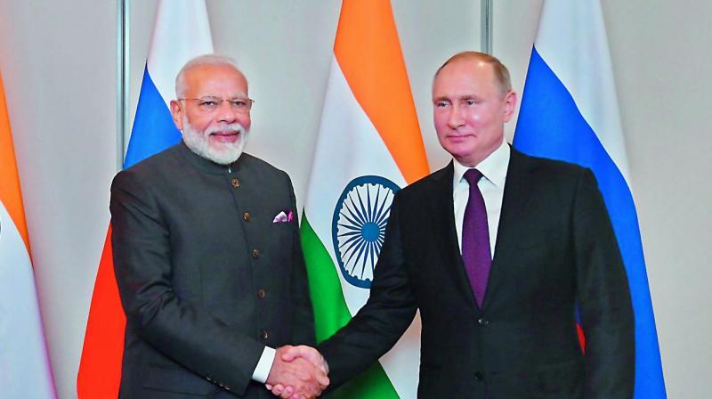 PM Narendra Modi with Russian President Vladimir Putin on the sidelines of Brics summit in Brazil.