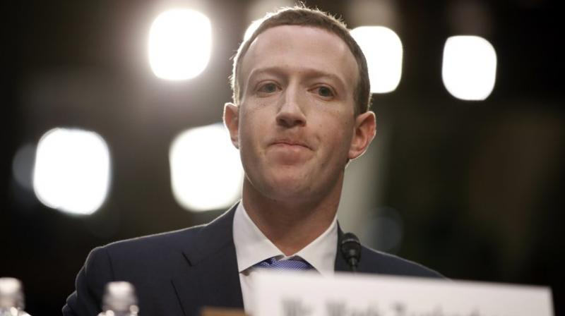 Facebook CEO Mark Zuckerberg testifies before a joint hearing of the Commerce and Judiciary Committees on Capitol Hill in Washington, Tuesday, April 10, 2018, about the use of Facebook data to target American voters in the 2016 election. (AP Photo/Alex Brandon)