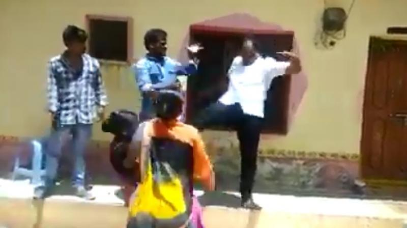 A video of the incident shows Immadi Gopi kicking the woman in full public view. (Photo: YouTube | Screengrab)