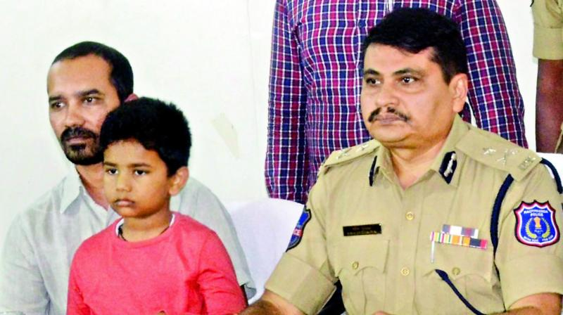 Rachakonda police commissioner Mahesh Bhagwat, along with kidnapped the boy, 7, and his father, addresses the media after the rescue. (Photo: P. Surendra)