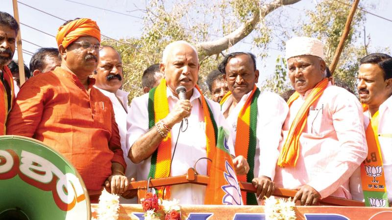 Chief Minister B.S. Yediyurappa addresses BJP workers after party candidate M.T.B. Nagaraj filed his papers for Hosakote seat