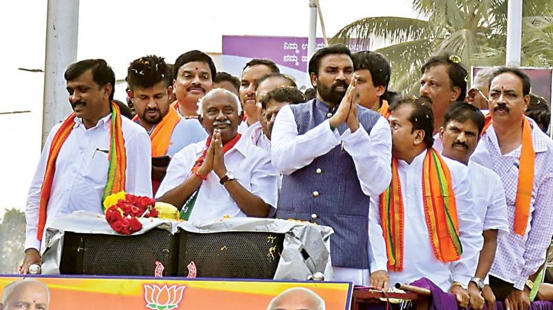 BJP candidate for Hunsur A.H. Vishwanath on his way to file his nomination papers on Monday