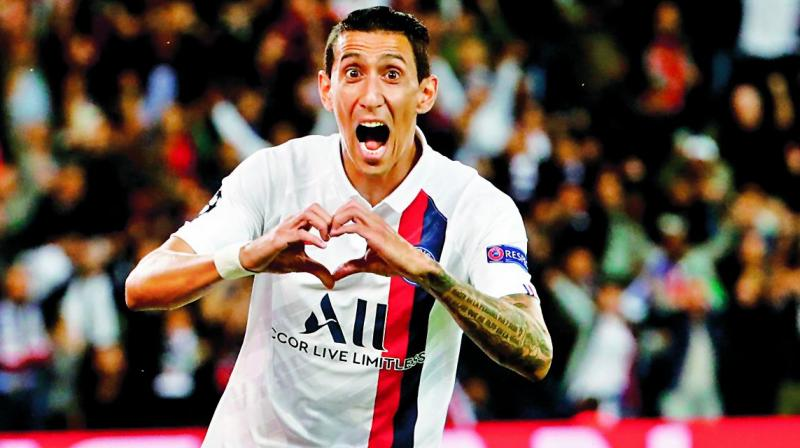 Paris Saint-Germain's Angel di Maria celebrates after scoring against Real Madrid in their Champions League Group 'A' match in Paris on Wednesday. (Photo: AFP)