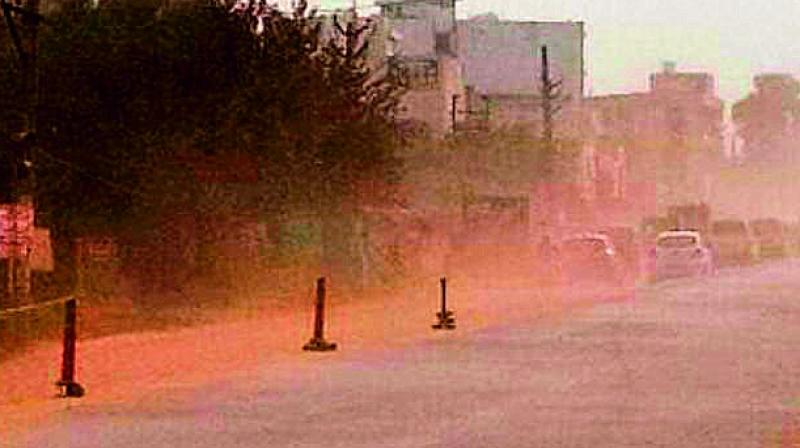 Dust from a construction site at Masjid Banda makes visibility difficult for commuters travelling on the route.