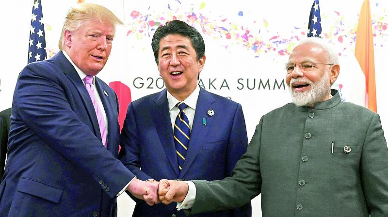 (Left to right) US President Donald Trump, Japanese Prime Minister Shinzo Abe and Prime Minister Narendra Modi attend a meeting during the G20 Osaka Summit on Friday.  (AFP)