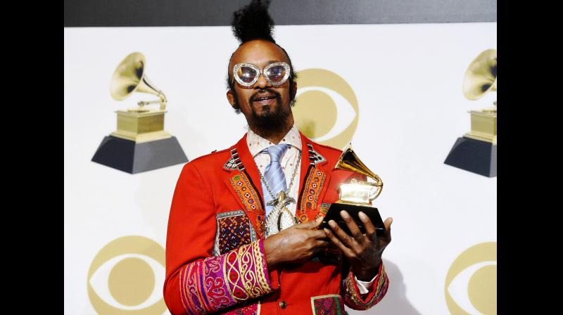 Fantastic Negrito dazzles in a red suit with colourful detailing. (Photo: AP)