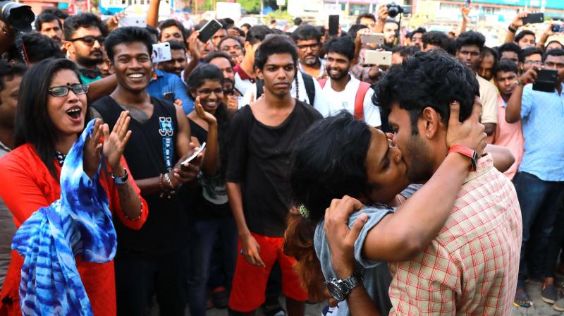 Activists protest Shiv Sena's moral policing by kissing in public at the Marine Drive in Kochi on Thursday. (Photo: ARUN CHANDRABOSE)