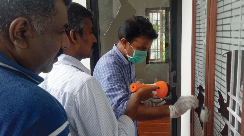 Finger prints experts collect samples at the Congress office in perambra in Kozhikode on Friday – DC