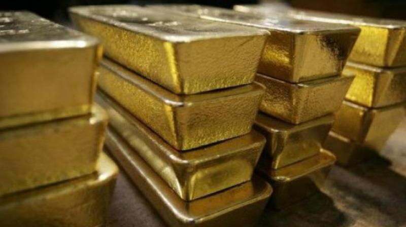 Globally, gold held steady at USD 1,294.06 an ounce and silver stood at USD 15.74 an ounce in New York.