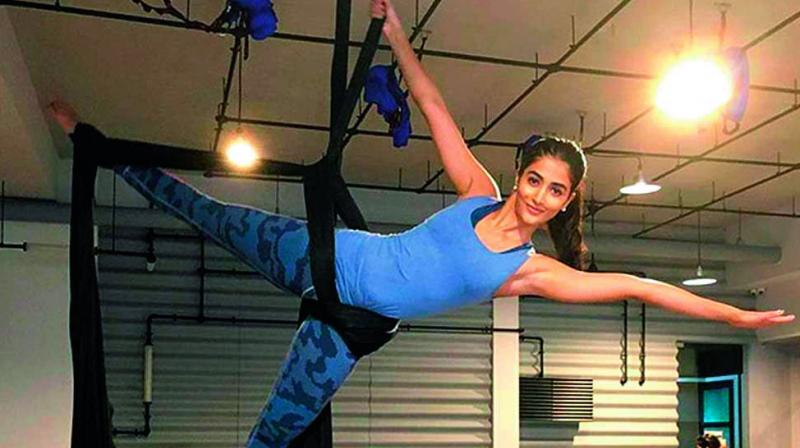 Shape of you: Pooja Hegde incorporates circuit and interval training in addition to calisthenics, Pilates, aerial silk moves and kickboxing in her fitness regimen.