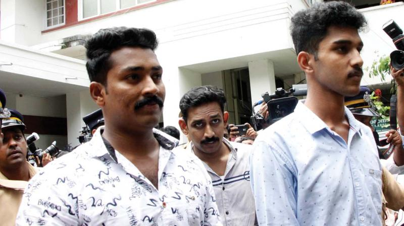 Fassal, Niyas and Ishan, convicted in the Kevin Joseph murder case, come out of the court after the judge pronounced their sentence. (Photo: Rajeev Prasad)