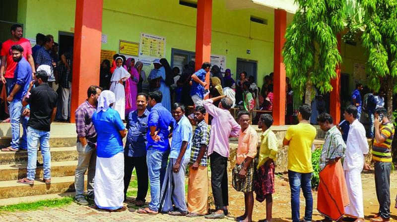 People wait in long queues to cast their votes at a polling station during the third phase of Lok Sabha polls at Batheri in Wayanad on Tuesday. (Photo: AP)